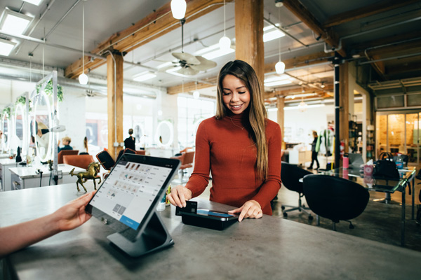equifax-freeze-unfreeze-credit-girl-paying-using-credit-card