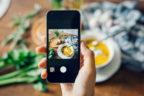 become-an-instagram-influencer-taking-a-picture-of-food